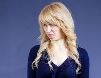 Disgusted woman with bad taste in mouth Royalty Free Stock Image