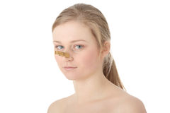 Disgusted woman with clothespin clipped to nose Royalty Free Stock Photography