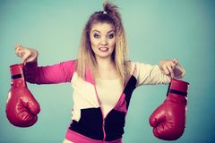 Disgusted woman holding boxing glove Royalty Free Stock Images