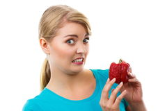 Disgusted woman holding in hand old wrinkled peppers, white background Royalty Free Stock Photo