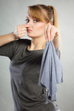 Disgusted woman holds dirty rag. Royalty Free Stock Image