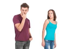 Disgusted woman looking at young man and leaving. royalty free stock images