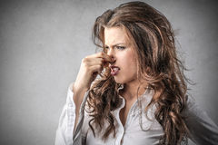Disgusted woman. A woman looks disgusted by something stock image