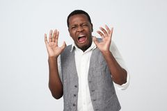 Disgusted young african american man grimacing, looking in terror and disgust. Feeling averse to do something stock images