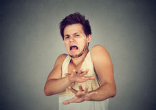 Disgusted young man. Negative human emotion. Portrait disgusted young man. Negative human emotion stock photos