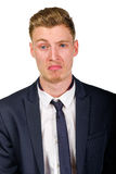 Disgusted young man wearing suit isolated Royalty Free Stock Image