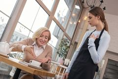 Furious woman not liking her coffee stock images