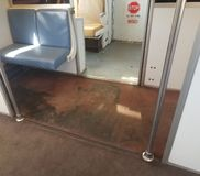 Disgusting gross dirty carpet in public transportation train. Disgusting gross dirty or filthy carpet or rug in public transportation train royalty free stock photography