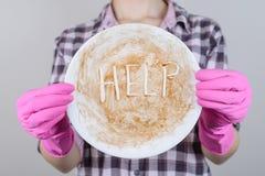 Dish потревоженное раковиной отрицательное checkered peo губки знака соуса рубашки стоковое фото rf