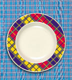 Dish. A empty dish on the table cloth stock photos