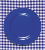 Dish. A empty dish on the table cloth royalty free stock photography