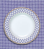 Dish. A empty dish on the table cloth royalty free stock image