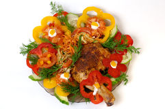 Dish 8. Delicious fried chicken with vegetables dish at a restaurant stock photo