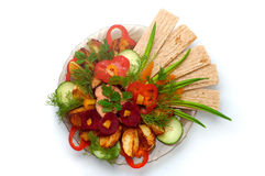 Dish 9. Delicious small loaf of bread with potato and vegetables dish at a restaurant stock photos