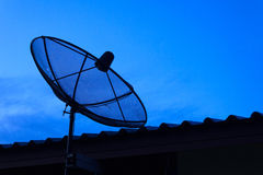 Dish aerial. Satellite dish with blue sky Royalty Free Stock Photography