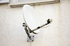 Dish aerial or Satellite dish on wall of House royalty free stock photos