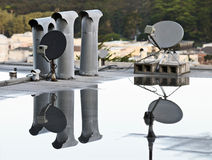 Dish Antennae on Rooftop Stock Photos