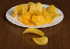 Dish with appetizing chips Royalty Free Stock Images