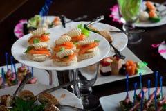 Dish with appetizing nourishing snacks Stock Images