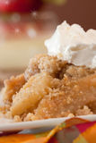 Dish Of Apple Crisp. A Dish Of Apple Crisp with Whipped Cream Topping and Eggnog stock photos
