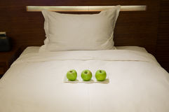 Dish of apples on bed Stock Images