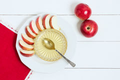 Dish with apples, honey and a spoon on white wooden background. Jewish New Year, Rosh Hashanah, top wiev Royalty Free Stock Photos
