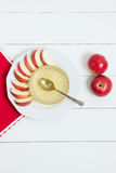 Dish with apples, honey and a spoon on white wooden background. Jewish New Year, Rosh Hashanah, top wiev Stock Image