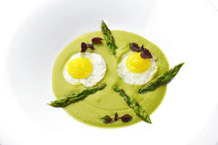 Dish of asparagus pureed quail eggs. Appetizes, fine gourmet dish of asparagus and eggs Royalty Free Stock Photography