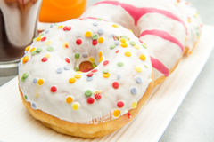 Dish with assorted donuts, coffee and juice Royalty Free Stock Photography