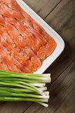 The dish for baking with thin slices of salmon Stock Photos