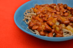 Dish of beans with buckwheat pasta Royalty Free Stock Photography