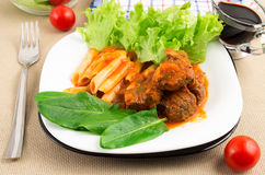 Dish of beef goulash with penne pasta, lettuce and spinach Stock Photos