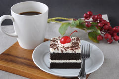 Dish of Black Forest Cake with Cup of Coffee Royalty Free Stock Photo