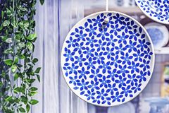 Dish with blue floral ornament in the interior of a modern kitchen royalty free stock photography