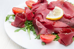 Dish of bresaola and aragula Stock Photo
