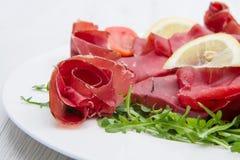 Dish of bresaola and aragula Stock Photography