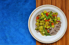 Dish of buckwheat pasta with vegetables Royalty Free Stock Image