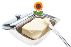 Dish of butter and table knife. On a white background Stock Photography