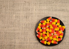 Dish of Candy Corn on Burlap with Area for Words Royalty Free Stock Photos