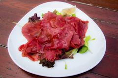 Carpaccio: italian dish of slices of raw beef. Dish of Carpaccio: an Italian appetizer consisting of thin slices of raw beef Stock Photography