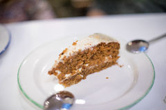 Dish with carrot cake piece and two spoons Stock Photos