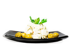 Dish with cheese olives and herbs Royalty Free Stock Photography