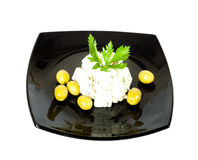 Dish with cheese olives and herbs Stock Photo
