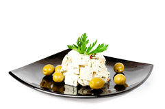 Dish with cheese olives and herbs Stock Images