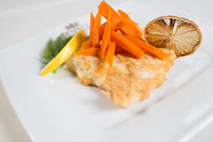 Dish of chicken chop with carrot and lemon Royalty Free Stock Image