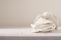 Dish cloth and crumbs on table Stock Photos