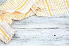 Dish cloth in yellow and white on wooden table Royalty Free Stock Image