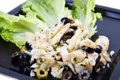 Dish of cod salad with black olives Stock Photo