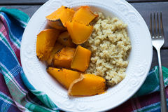 A dish of cooked pumpkin and quinoa Royalty Free Stock Photo