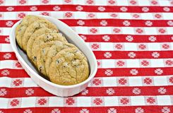 Dish of cookies. A dish of chocolate chip cookies on a red gingham tablecloth Royalty Free Stock Image